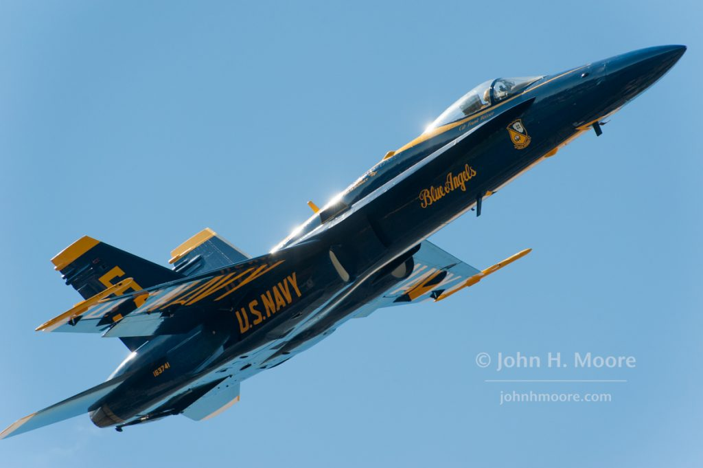 Plane 6 of the US Navy Blue Angels does a close flyby at the 2016 Miramar Air Show